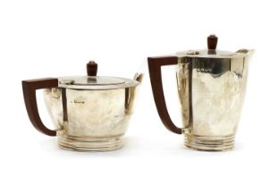 A silver teapot and a hot water jug,