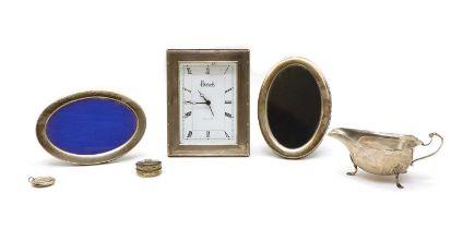 A silver cased Harrods boudoir clock,