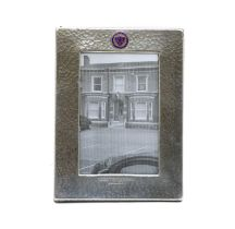 An Art Deco hammered pewter easel backed photograph frame,