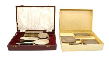 A cased silver dressing table set,