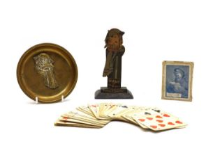 A painted wood jigsaw cut upstand of ' Old Bill at Oxford',