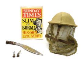 A WWII Burma campaign steel helmet,