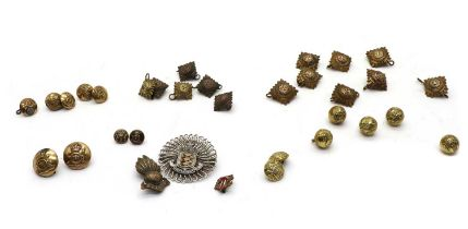 A collection of military uniform buttons,