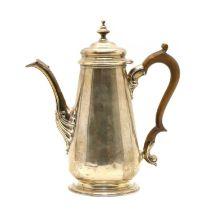 A silver coffee pot,