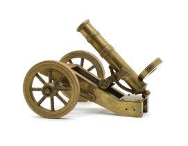 A scratch built brass model of a field cannon or Maxim gun,