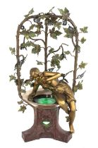 An unusual Art Nouveau cold-painted spelter table lamp,