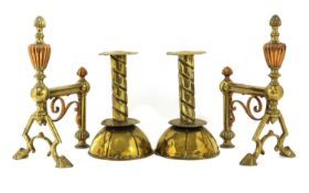 A pair of Arts and Crafts brass candlesticks,