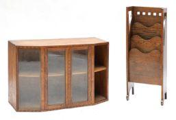 A Cotswold School glazed oak bookcase,