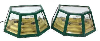 A pair of green wall lights,