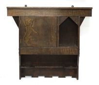 An Arts and Crafts hanging smoker's cabinet,