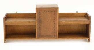 An Arts and Crafts oak hanging wall cabinet,