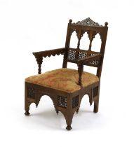 An Aesthetic Movement Moorish mahogany armchair,