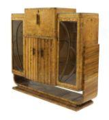 An Art Deco burr walnut cocktail cabinet,