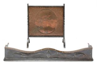 An Arts and Crafts bronze and copper fender,