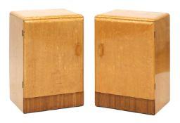 A pair of Art Deco bird's-eye maple bedside cupboards,