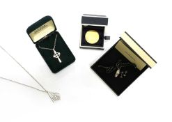 Two sterling silver pendants, by Ola Gorie,