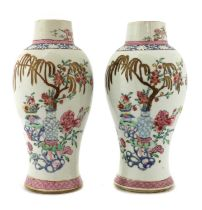 A pair of Chinese export famille rose vases,