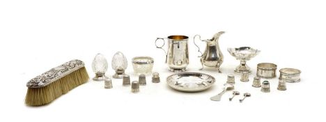 A silver christening mug,
