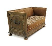A Continental oak trunk sofa,