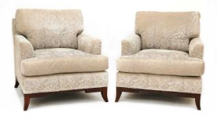 A pair of contemporary Baker lounge chairs,
