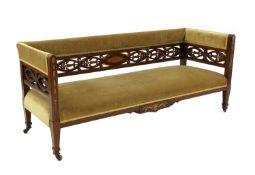 An Edwardian mahogany salon settee,