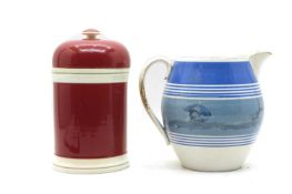 A pink-glazed pottery drug jar,