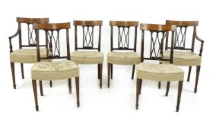 A set of six Edwardian mahogany and inlaid satin wood bar back dining chairs