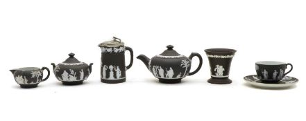 A collection of black Wedgwood jasperware items,