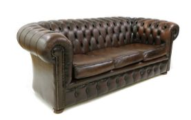 A brown leather three seater Chesterfield sofa,
