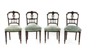 A set of four Edwardian walnut dining chairs,