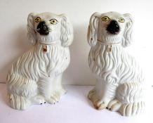 A pair of 19th century Staffordshire spaniels(25cm high)