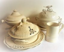 A selection of modern kitchen creamware to include lidded tureens and platters