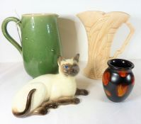 A pottery group of four; a Lovatts green-glaze jug, an Art Deco period Arthur Wood jug, a