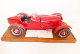 A hand-built plastic model of an Alfa-Romeo open-top racing car together with instructions etc. on a