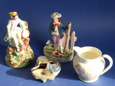 A mixed pottery group of four: two mid-19th century Staffordshire figures, one with a shepherd