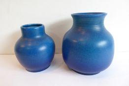 Two Royal Lancastrian electric-blue porcelain vases (19cm and 15cm high)