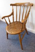 An early 20th century desk-style chair having oval elm seat