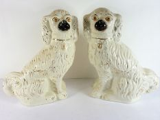 A large pair of 19th century Staffordshire Pottery spaniels (33cm high)
