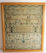 A George IV (dated 1820) framed and glazed (later) needlework sampler; intricately sewn with