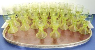 A set of 26 Art Deco-style green uranium glass goblets