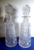 A pair of finely hand-cut early 20th century heavy crystal decanters of conical form; small
