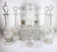 Seven decanters (two pairs measuring 23cm and 30cm high) and a carafe, 18th and 19th century