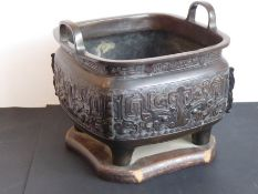 A large mid-19th centuryJapanesetwo-handled temple censer in patinated bronze; Xuande mark below