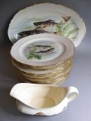 Twelve French porcelain plates with gilded borders and decorated with six different fish designs (