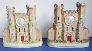 A pair of 1860/70 pottery models of castles decorated with clock faces, small loss to the top of one