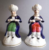 Two unusual 19th century Staffordshire-style figures; both modelled as seated moustachioed males