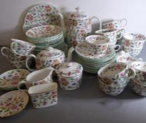 A Minton 'Haddon Hall' part tea service to include cups, saucers, teapot, coffee pot and lidded