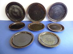 Eight Winchcombe Pottery stoneware plates with Tenmoku glaze: three 24cm dinner plates and five side