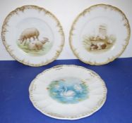 A pair of early 20th century French porcelain cabinet-style plates: each hand-decorated, one with