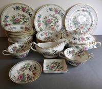 A quantity of Pembroke dinner wares in the (reproduced) 18th century Aynsley design: to include